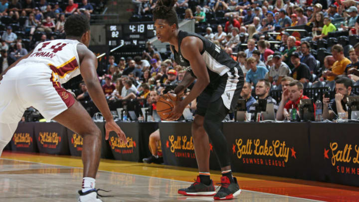 SALT LAKE CITY, UT - JULY 1: Lonnie Walker IV #1 of the San Antonio Spurs handles the ball during the game against Malik Newman #14 of the Cleveland Cavaliers (Photo by Melissa Majchrzak/NBAE via Getty Images)