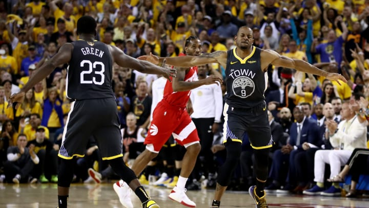 OAKLAND, CALIFORNIA – JUNE 13: Potential San Antonio Spurs trade target Andre Iguodala #9 of the Golden State Warriors celebrates the play against the Toronto Raptors in the second half during Game Six of the 2019 NBA Finals at ORACLE Arena on June 13, 2019 in Oakland, California. (Photo by Ezra Shaw/Getty Images)