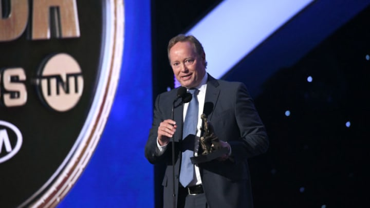 SANTA MONICA, CALIFORNIA - JUNE 24: Mike Budenholzer accepts the NBA Coach of the Year award onstage during the 2019 NBA Awards presented by Kia on TNT at Barker Hangar on June 24, 2019 in Santa Monica, California. (Photo by Michael Kovac/Getty Images for Turner Sports)