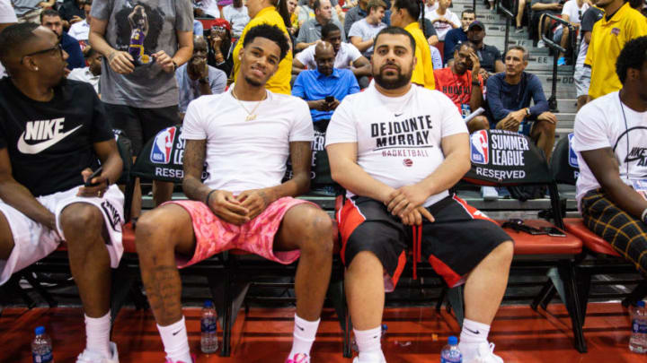 LAS VEGAS, NEVADA - JULY 08: Dejounte Murray (L) and guest sit court side during a game at NBA Summer League on July 08, 2019 in Las Vegas, Nevada. (Photo by Cassy Athena/Getty Images)