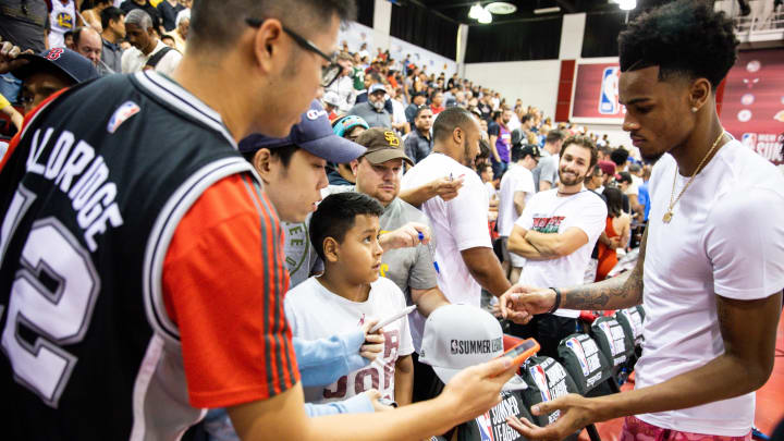 LAS VEGAS, NEVADA – JULY 08: Dejounte Murray signs autographs during a game at NBA Summer League on July 08, 2019 in Las Vegas, Nevada. (Photo by Cassy Athena/Getty Images)