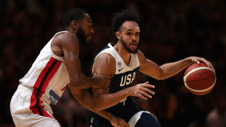 Derrick White (R) of the San Antonio Spurs fights for the ball with Aaron Best of Canada during their friendly basketball match in Sydney on August 26, 2019, ahead of the World Basketball Championships in China starting on August 31. (Photo by SAEED KHAN / AFP) / -- IMAGE RESTRICTED TO EDITORIAL USE - STRICTLY NO COMMERCIAL USE -- (Photo credit should read SAEED KHAN/AFP/Getty Images)