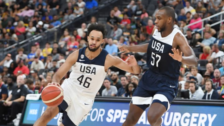 LAS VEGAS, NEVADA - AUGUST 09: Derrick White #46 of the 2019 USA Men's Select Team drives against Khris Middleton #57 of the 2019 USA Men's National Team during the 2019 USA Basketball Men's National Team Blue-White exhibition game at T-Mobile Arena on August 9, 2019 in Las Vegas, Nevada. (Photo by Ethan Miller/Getty Images)