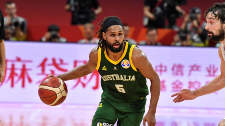 BEIJING, CHINA - SEPTEMBER 13: Patty Mills #5 of Australia handles the ball against Spain during the 2019 FIBA World Cup Semi-Finals at the Wukesong Sport Arena on September 13, 2019 in Beijing, China. NOTE TO USER: User expressly acknowledges and agrees that, by downloading and/or using this Photograph, user is consenting to the terms and conditions of the Getty Images License Agreement. Mandatory Copyright Notice: Copyright 2019 NBAE (Photo by Jesse D. Garrabrant/NBAE via Getty Images)