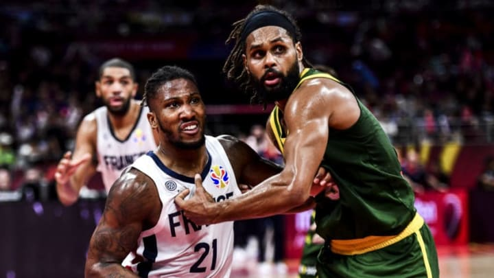 BEIJING, CHINA - SEPTEMBER 15: #5 Patty Mills of Australia and #21 Andrew Albicy of France fight for the ball during the 3rd place games between France and Australia of 2019 FIBA World Cup at the Cadillac Arena on September 15, 2019 in Beijing, China. (Photo by Di Yin/Getty Images)