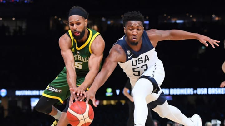 MELBOURNE, AUSTRALIA - AUGUST 22: Patrick Mills of the Boomers and the San Antonio Spurs and Donovan Mitchell of the USA compete for the ball during the International Basketball Friendly match between the Australian Boomers and Team USA United States of America at Marvel Stadium on August 22, 2019 in Melbourne, Australia. (Photo by Quinn Rooney/Getty Images)