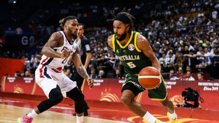 NANJING, CHINA - SEPTEMBER 09: Patty Mills(R) #5 of Australia in action against Andrew Albicy #21 of France during 2nd round Group L match between Australia and France of 2019 FIBA World Cup at Nanjing Youth Olympic Sports Park Gymnasium on September 09, 2019 in Nanjing, China. (Photo by Shi Tang/Getty Images)