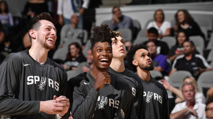 SAN ANTONIO, TX – OCTOBER 5: Drew Eubanks #14 of the San Antonio Spurs and Lonnie Walker IV #1 of the San Antonio Spurs share a laugh before a game against the Orlando Magic (Photos by Logan Riely/NBAE via Getty Images)