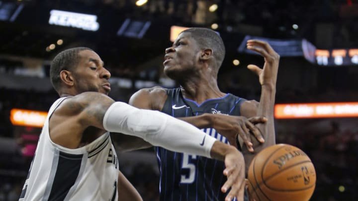 SAN ANTONIO,TX - OCTOBER 5: LaMarcus Aldridge #12 of the San Antonio Spurs knocks the ball away from Mo Bamba #5 of the Orlando Magic in pre-season game at AT&T Center on October 5 , 2019 in San Antonio, Texas. (Photo by Ronald Cortes/Getty Images)