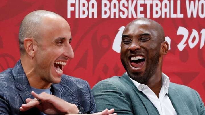 BEIJING, CHINA – SEPTEMBER 13: (L-R) Former players Emanuel Ginobili and Kobe Bryant react during the semi-finals march between Spain and Australia of 2019 FIBA World Cup (Photo by Xinyu Cui/Getty Images)