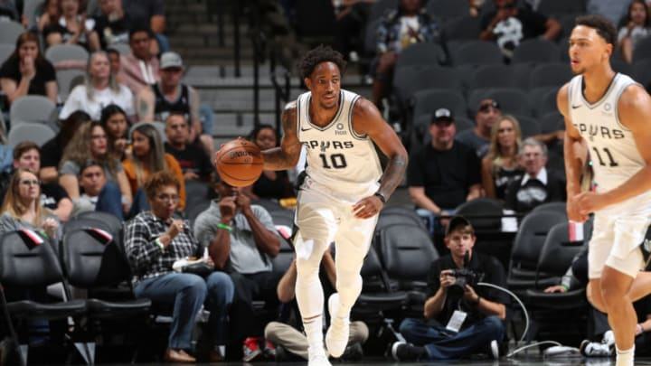 SAN ANTONIO, TX - OCTOBER 13: DeMar DeRozan #10 of the San Antonio Spurs handles the ball against the New Orleans Pelicans during a pre-season game on October 13, 2019 at the AT&T Center in San Antonio, Texas. NOTE TO USER: User expressly acknowledges and agrees that, by downloading and or using this photograph, user is consenting to the terms and conditions of the Getty Images License Agreement. Mandatory Copyright Notice: Copyright 2019 NBAE (Photos by Joe Murphy/NBAE via Getty Images)