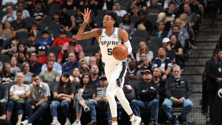 SAN ANTONIO, TX – OCTOBER 13: Dejounte Murray #5 of the San Antonio Spurs handles the ball against the New Orleans Pelicans during a pre-season game on October 13, 2019 (Photos by Joe Murphy/NBAE via Getty Images)