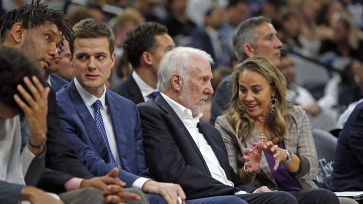 SAN ANTONIO, TX – OCTOBER 13: Spurs coaches Tim Duncan, Will Hardy, Gregg Popovich, and Becky Hammon talk during a preseason game against the New Orleans Pelicans at AT&T Center. (Photo by Ronald Cortes/Getty Images)
