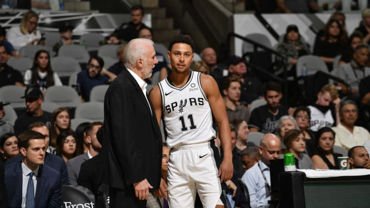 SAN ANTONIO, TX – OCTOBER 13: Bryn Forbes #11 of the San Antonio Spurs talks to Head Coach Gregg Popovich during a game against the New Orleans Pelicans during a pre-season (Photos by Logan Riely/NBAE via Getty Images)