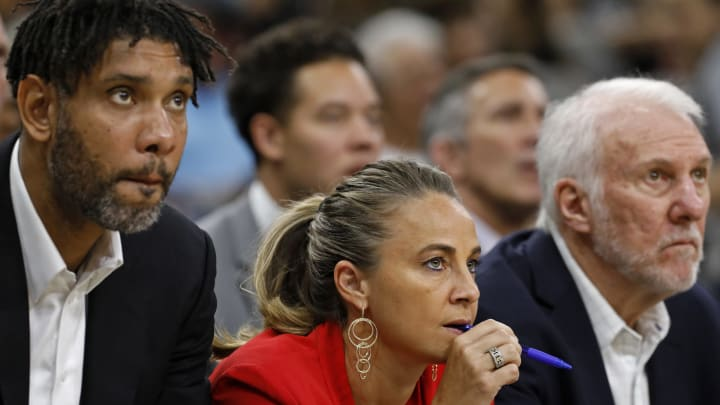 SAN ANTONIO, TX – OCTOBER 18: San Antonio Spurs assistant coaches Tim Duncan, Becky Hammon, and head coach Gregg Popovich. (Photo by Edward A. Ornelas/Getty Images)