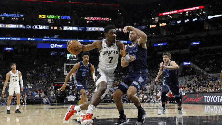 SAN ANTONIO, TX - OCTOBER 18: Chimezie Metu #7 of the San Antonio Spurs drives around John Konchar #46 of the Memphis Grizzlies during a preseason NBA game held at the AT&T Center (Photo by Edward A. Ornelas/Getty Images)