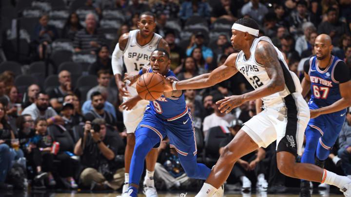 RJ Barrett of the New York Knicks goes for a loose ball against Rudy Gay. (Photos by Garrett Ellwood/NBAE via Getty Images)