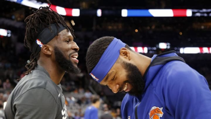 SAN ANTONIO,TX - OCTOBER 23: Marcus Morris #13 of the New York Knicks jokes with DeMarre Carroll #77 of the San Antonio Spurs before the start of their game at AT&T Center on October 23 , 2019 in San Antonio, Texas. NOTE TO USER: User expressly acknowledges and agrees that , by downloading and or using this photograph, User is consenting to the terms and conditions of the Getty Images License Agreement. (Photo by Ronald Cortes/Getty Images)
