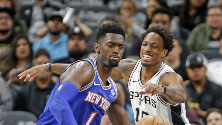 SAN ANTONIO, TX – OCTOBER 23: DeMar DeRozan #10 of the San Antonio Spurs tries to steal the ball away from Bobby Portis #1 of the New York Knicks at AT&T Center. (Photo by Ronald Cortes/Getty Images)