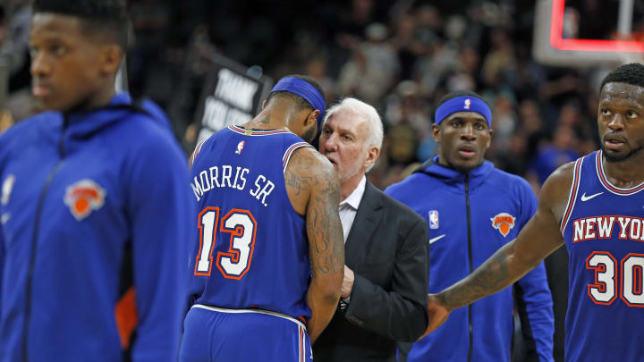 SAN ANTONIO,TX – OCTOBER 23: Head coach of the San Antonio Spurs Gregg Popovich talks to Marcus Morris #13 of the Knicks after the Spurs defeated New York 120-11 at AT&T Center (Photo by Ronald Cortes/Getty Images)