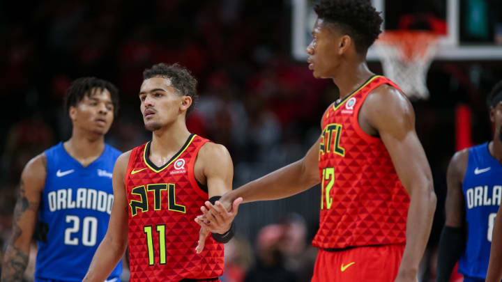 ATLANTA, GA – OCTOBER 26: Trae Young #11 high fives De'Andre Hunter #12 of the Atlanta Hawks during the fourth quarter of a game against the Orlando Magic (Photo by Carmen Mandato/Getty Images)