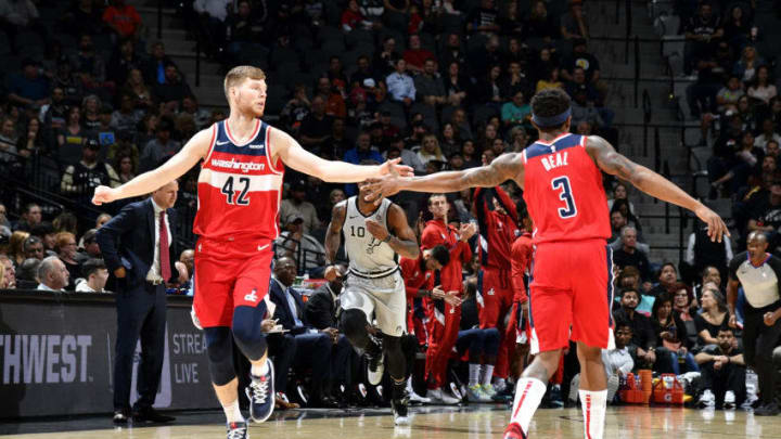 Davis Bertans high fives teammate Bradley Beal of the Washington Wizards during a game against the San Antonio Spurs. (Photos by Logan Riely/NBAE via Getty Images)