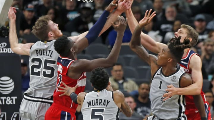 SAN ANTONIO,TX – OCTOBER 26: Jakob Poeltl #25 of the San Antonio Spurs and Lonnie Walker #1 battle the Washington Wizards for a rebound at AT&T Center on October 26, 2019 (Photo by Ronald Cortes/Getty Images)