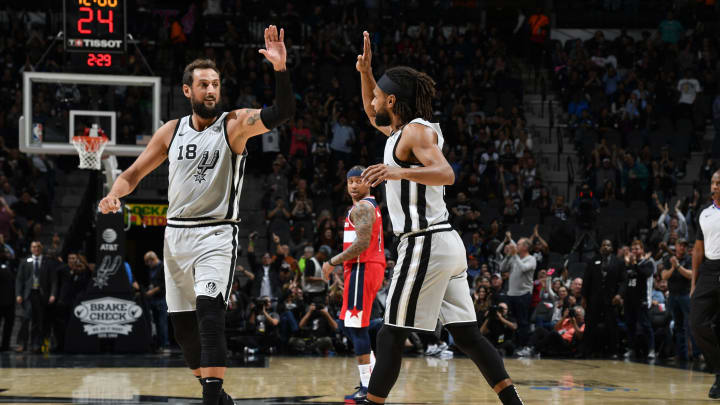 SAN ANTONIO, TX – OCTOBER 26: Marco Belinelli #18 of high fives teammate Patty Mills #8 of the San Antonio Spurs during a game against the Washington Wizards on October 26, 2019 (Photos by Logan Riely/NBAE via Getty Images)