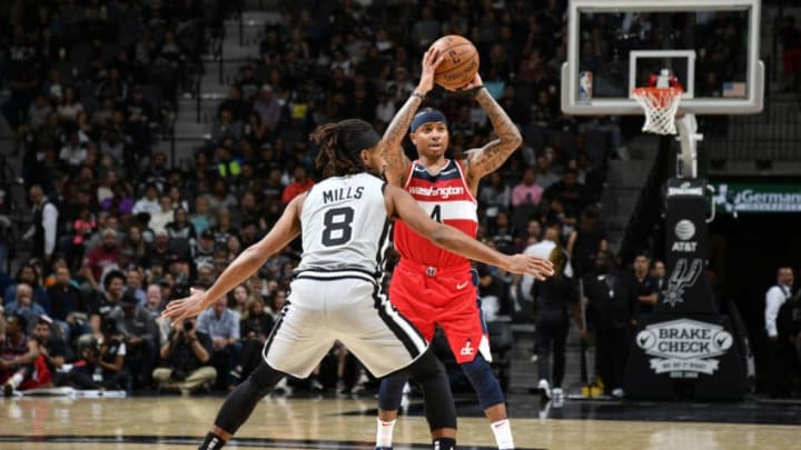 Isaiah Thomas of the Washington Wizards looks to pass the ball against the San Antonio Spurs. (Photos by Logan Riely/NBAE via Getty Images)