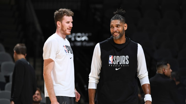 SAN ANTONIO, TX – OCTOBER 28: Jakob Poeltl #25, and Assistant Coach Tim Duncan talk during the game before the game against the Portland Trail Blazers on October 28, 2019 (Photos by Garrett Ellwood/NBAE via Getty Images)
