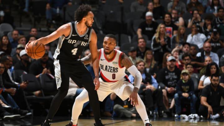 Derrick White of the San Antonio Spurs handles the ball against the Portland Trail Blazers.(Photos by Garrett Ellwood/NBAE via Getty Images)