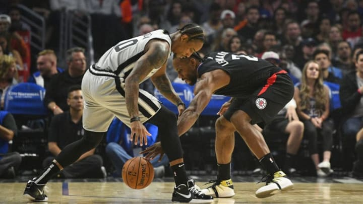 LOS ANGELES, CA - OCTOBER 31: San Antonio Spurs Forward DeMar DeRozan (10) and Los Angeles Clippers Forward Kawhi Leonard (2) fight for a loose ball during a NBA game between the San Antonio Spurs and the Los Angeles Clippers on October 31, 2019 at STAPLES Center in Los Angeles, CA. (Photo by Brian Rothmuller/Icon Sportswire via Getty Images)