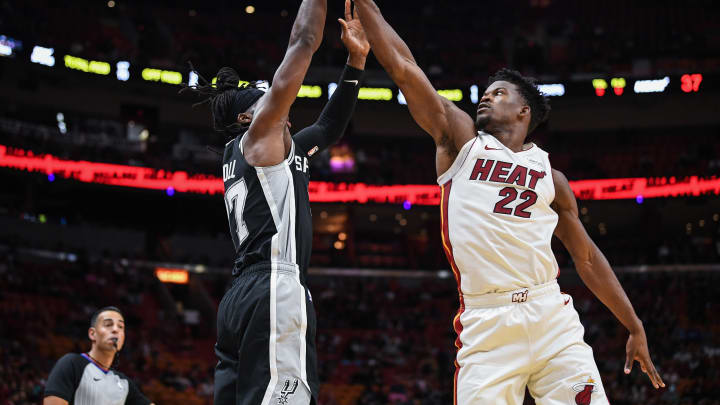 MIAMI, FLORIDA – OCTOBER 08: Jimmy Butler #22 of the Heat defends against DeMarre Carroll #77 of the San Antonio Spurs during a preseason game at American Airlines Arena on Oct. 08, 2019 (Photo by Mark Brown/Getty Images)