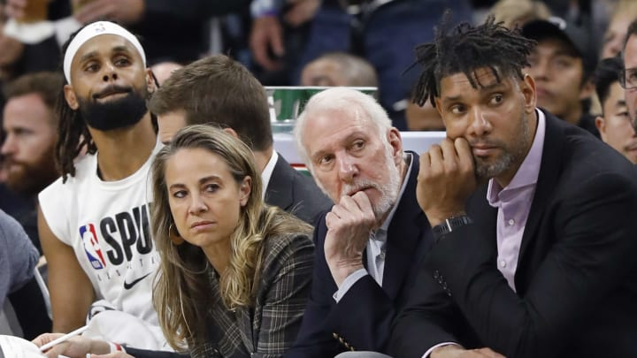 SAN ANTONIO, TX – NOVEMBER 07: (L-R) Patty Mills #8 of the San Antonio Spurs, assistant coach Becky Hammon, head coach Gregg Popovich, and assistant coach Tim Duncan watch action from the bench. (Photo by Edward A. Ornelas/Getty Images)
