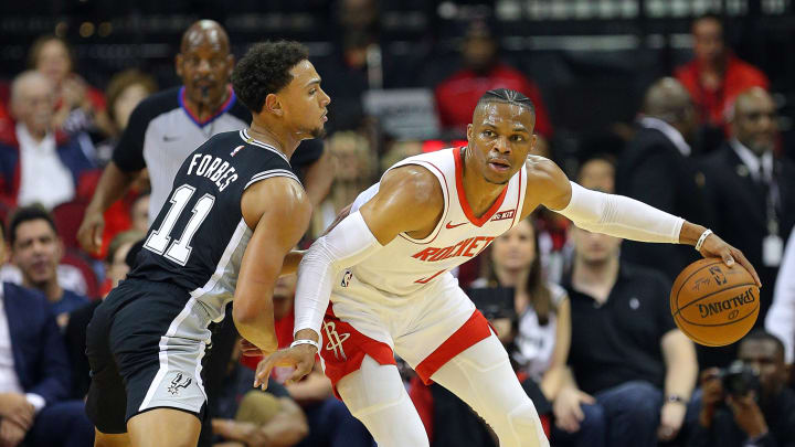 Russell Westbrook is guarded by Bryn Forbes (Photo by Bob Levey/Getty Images)