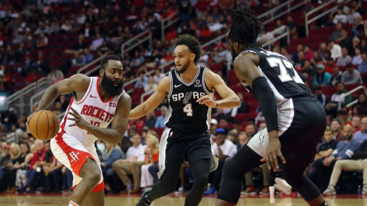 James Harden of the Houston Rockets drives through the San Antonio Spurs (Photo by Bob Levey/Getty Images)
