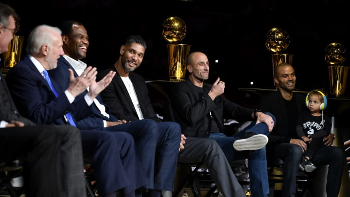 Assistant Coach Tim Duncan of the San Antonio Spurs and Manu Ginobili smile during the Tony Parker Jersey Retirement Ceremony. (Photos by Logan Riely/NBAE via Getty Images)