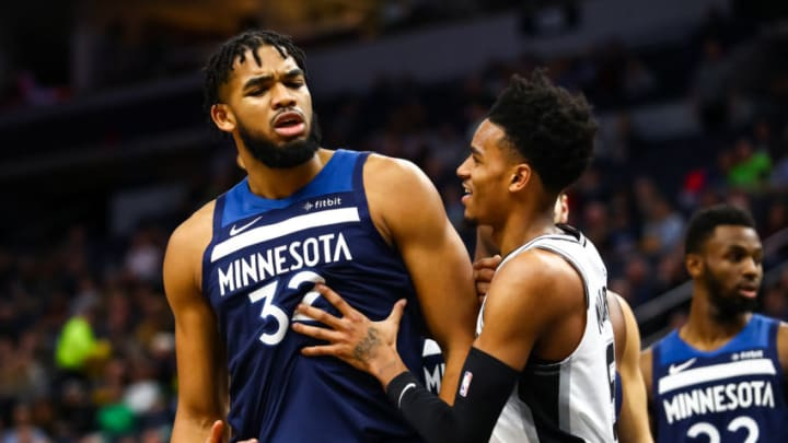 MINNEAPOLIS, MN - NOVEMBER 13: Karl-Anthony Towns #32 of the Minnesota Timberwolves is held back by Dejounte Murray #5 of the San Antonio Spurs after Towns got into a scrum with Rudy Gay #22 (not pictured) in the second quarter of the game at Target Center on November 13, 2019 in Minneapolis, Minnesota. NOTE TO USER: User expressly acknowledges and agrees that, by downloading and or using this Photograph, user is consenting to the terms and conditions of the Getty Images License Agreement. (Photo by David Berding/Getty Images)