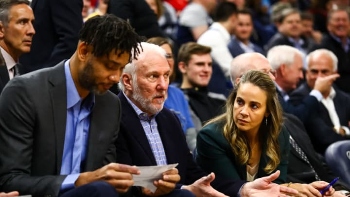 MINNEAPOLIS, MN - NOVEMBER 13: (L-R) Tim Duncan, Gregg Popovitch, and Becky Hammon of the San Antonio Spurs talk during the second quarter of the game against the Minnesota Timberwolves at Target Center on November 13, 2019 in Minneapolis, Minnesota. The Timberwolves defeated the spurs 129-114. NOTE TO USER: User expressly acknowledges and agrees that, by downloading and or using this Photograph, user is consenting to the terms and conditions of the Getty Images License Agreement. (Photo by David Berding/Getty Images)