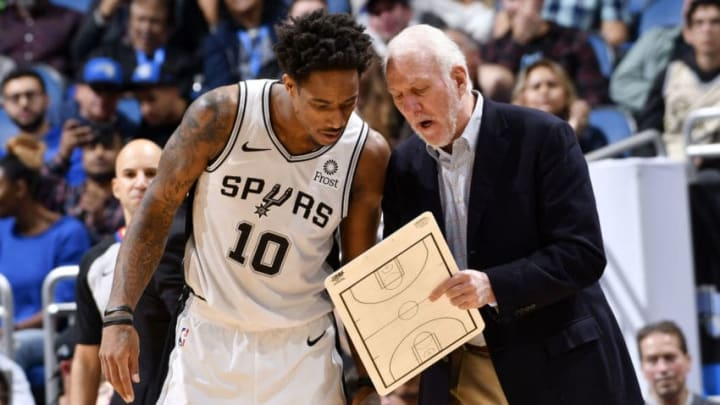 DeMar DeRozan #10 of the San Antonio Spurs and Gregg Popovich. (Photo by Fernando Medina/NBAE via Getty Images)