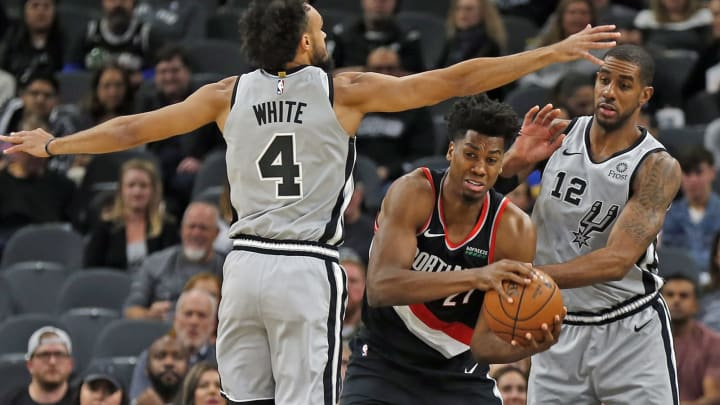 SAN ANTONIO, TX – NOVEMBER 16: Hassan Whiteside #21 of the Portland Trail Blazers is defended by Derrick White #4 and LaMarcus Aldridge #12 of the San Antonio Spurs. (Photo by Ronald Cortes/Getty Images)