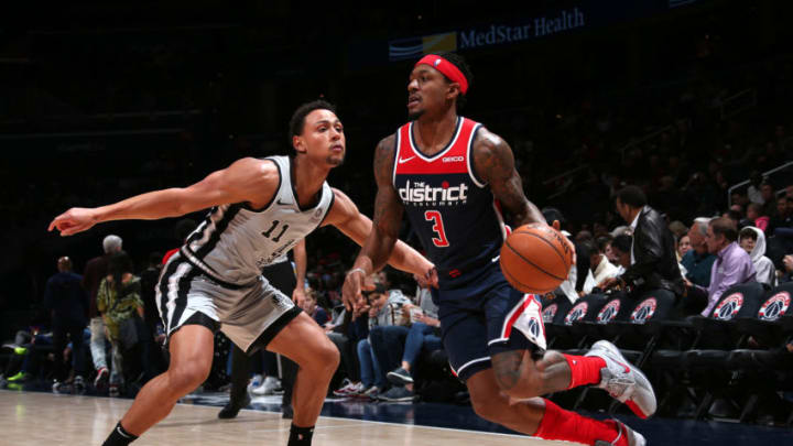 Bradley Beal of the Washington Wizards handles the ball against Bryn Forbes of the San Antonio Spurs. (Photo by Ned Dishman/NBAE via Getty Images)