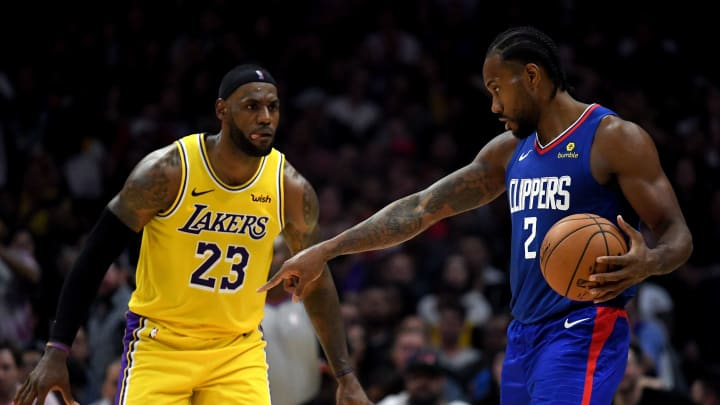 LOS ANGELES, CALIFORNIA – OCTOBER 22: Kawhi Leonard #2 of the LA Clippers controls possession of the ball in front of LeBron James #23 of the Los Angeles Lakers (Photo by Harry How/Getty Images)