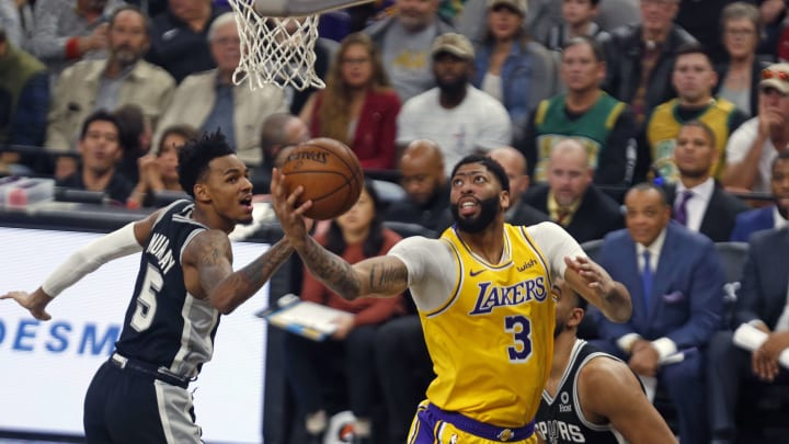 SAN ANTONIO,TX – NOVEMBER 25: Anthony Davis #3 of the Los Angeles Lakers drives to the basket past Dejounte Murray #5 of the San Antonio Spurs at AT&T Center. (Photo by Ronald Cortes/Getty Images)