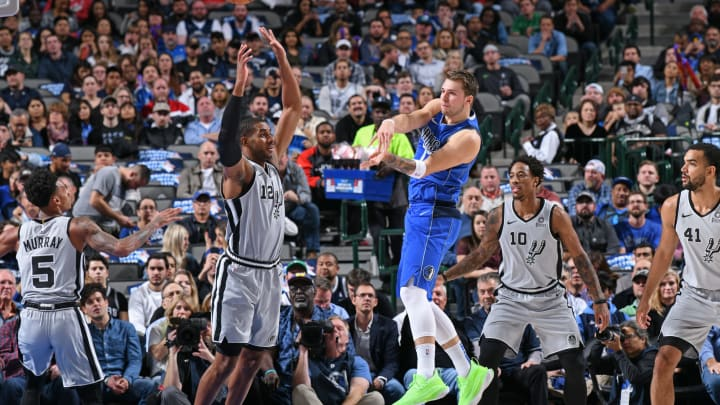 DALLAS, TX – NOVEMBER 18: Luka Doncic #77 of the Dallas Mavericks passes the ball against the San Antonio Spurs on November 18, 2019 at the American Airlines Center (Photo by Glenn James/NBAE via Getty Images)