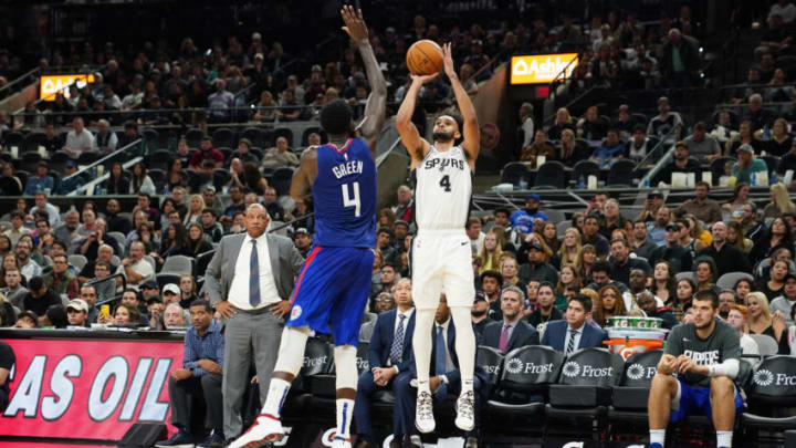 SAN ANTONIO, TX - NOVEMBER 29: Derrick White #4 of the San Antonio Spurs shoots the ball against the LA Clippers on November 29, 2019 at the AT&T Center in San Antonio, Texas. NOTE TO USER: User expressly acknowledges and agrees that, by downloading and or using this photograph, user is consenting to the terms and conditions of the Getty Images License Agreement. Mandatory Copyright Notice: Copyright 2019 NBAE (Photos by Darren Carroll/NBAE via Getty Images)