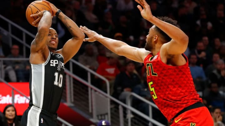ATLANTA, GEORGIA - NOVEMBER 05: DeMar DeRozan #10 of the San Antonio Spurs shoots against Jabari Parker #5 of the Atlanta Hawks in the second half at State Farm Arena on November 05, 2019 in Atlanta, Georgia. NOTE TO USER: User expressly acknowledges and agrees that, by downloading and/or using this photograph, user is consenting to the terms and conditions of the Getty Images License Agreement. (Photo by Kevin C. Cox/Getty Images)