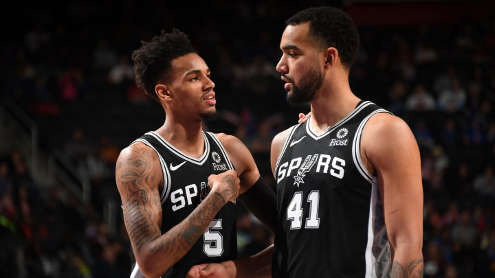 San Antonio Spurs point guard Dejounte Murray shares a conversation with teammate Trey Lyles while facing the Detroit Pistons. (Photo by Chris Schwegler/NBAE via Getty Images)