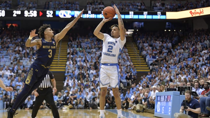 CHAPEL HILL, NORTH CAROLINA – NOVEMBER 06: Cole Anthony #2 of the North Carolina Tar Heels shoots over Prentiss Hubb #3 of the Notre Dame Fighting Irish during the second half at the Dean Smith Center on November 06, 2019 in Chapel Hill, North Carolina. North Carolina won 76-65. (Photo by Grant Halverson/Getty Images)