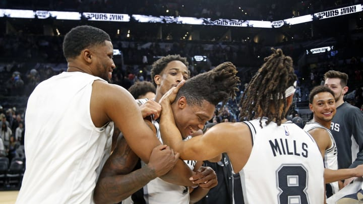 SAN ANTONIO, TX – DECEMBER 3: Lonnie Walker #1 of the San Antonio Spurs is swarmed by teammates after defeating the Houston Rockets in 2OT at AT&T Center on December 3, 2019. (Photo by Ronald Cortes/Getty Images)